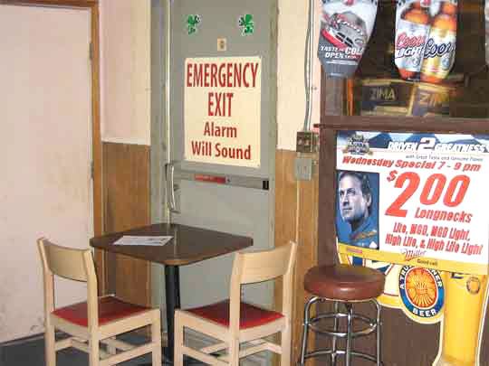 chairs and table blocking exit door